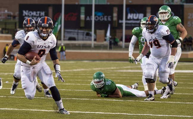 Nov 23, 2013; Denton, TX, USA; UTSA Roadrunners quarterback Eric Soza (8) runs for a touchdown during the second half against the North Texas Mean Green at Apogee Stadium. The Roadrunners defeated the Mean Green 21-13. Mandatory Credit: Jerome Miron-USA TODAY Sports