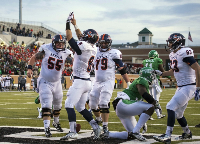 Nov 23, 2013; Denton, TX, USA; UTSA Roadrunners quarterback Eric Soza (8) celebrates a touchdown during the second half against the North Texas Mean Green at Apogee Stadium. The Roadrunners defeated the Mean Green 21-13. Mandatory Credit: Jerome Miron-USA TODAY Sports