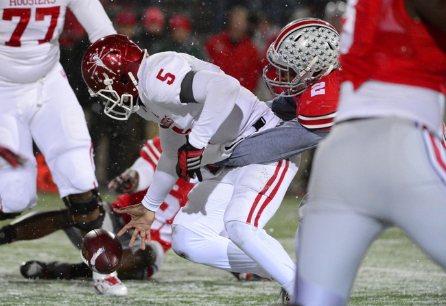 Nov 23, 2013; Columbus, OH, USA; Indiana Hoosiers quarterback Tre Roberson (5) fumbles the ball against the Ohio State Buckeyes at Ohio Stadium. Ohio State Buckeyes beat the Indiana Hoosiers 42 to 14. Mandatory Credit: Marc Lebryk-USA TODAY Sports