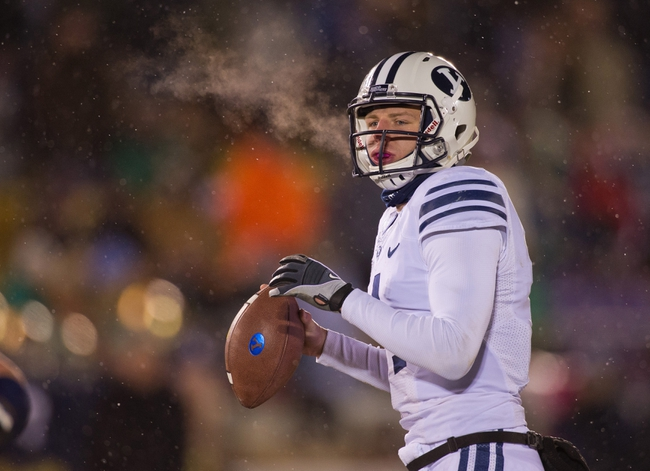 Nov 23, 2013; South Bend, IN, USA; BYU Cougars quarterback Taysom Hill (4) looks for a receiver in the third quarter against the Notre Dame Fighting Irish at Notre Dame Stadium. Notre Dame won 23-13. Mandatory Credit: Matt Cashore-USA TODAY Sports