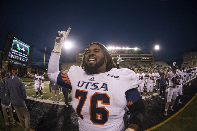 Nov 23, 2013; Denton, TX, USA; UTSA Roadrunners guard Josh Walker (76) celebrates the win over the North Texas Mean Green at Apogee Stadium. The Roadrunners defeated the Mean Green 21-13. Mandatory Credit: Jerome Miron-USA TODAY Sports