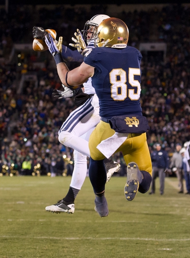 Nov 23, 2013; South Bend, IN, USA; BYU Cougars safety Craig Bills (20) intercepts a pass intended for Notre Dame Fighting Irish tight end Troy Niklas (85) in the fourth quarter at Notre Dame Stadium. Notre Dame won 23-13. Mandatory Credit: Matt Cashore-USA TODAY Sports