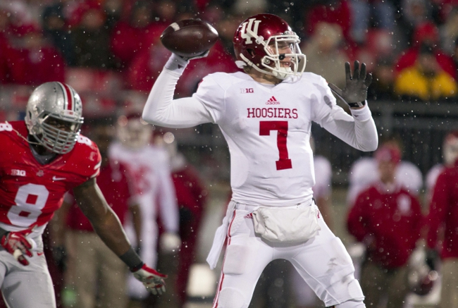 Nov 23, 2013; Columbus, OH, USA;  Indiana Hoosiers quarterback Nate Sudfeld (7) passes the ball in the third quarter of the game against the Ohio State Buckeyes at Ohio Stadium. Ohio State Buckeyes beat Indiana Hoosiers 42-14. Mandatory Credit: Trevor Ruszkowksi-USA TODAY Sports