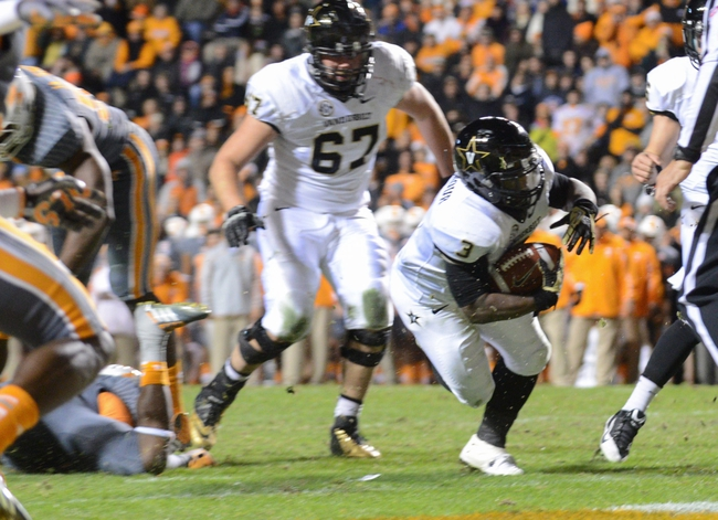 Nov 23, 2013; Knoxville, TN, USA; Vanderbilt Commodores running back Jerron Seymour (3) scores a touchdown during the first quarter against the Tennessee Volunteers at Neyland Stadium. Mandatory Credit: Randy Sartin-USA TODAY Sports