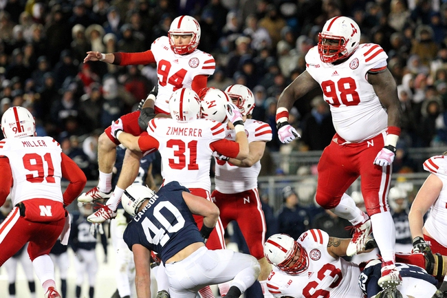 Nov 23, 2013; University Park, PA, USA; Nebraska Cornhuskers kicker Pat Smith (94) celebrates with teammates after kicking the winning field goal during overtime against the Penn State Nittany Lions at Beaver Stadium. Nebraska defeated Penn State 23-20 in overtime. Mandatory Credit: Matthew O'Haren-USA TODAY Sports