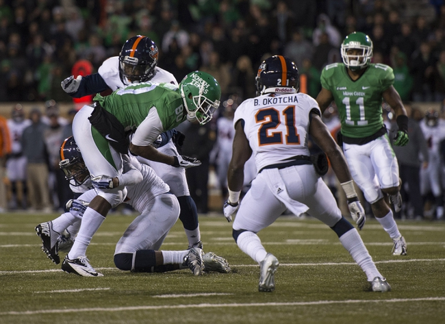 Nov 23, 2013; Denton, TX, USA; North Texas Mean Green wide receiver Darnell Smith (80) is stopped short of the end zone with one second remaining against the UTSA Roadrunners at Apogee Stadium. The Roadrunners defeated the Mean Green 21-13. Mandatory Credit: Jerome Miron-USA TODAY Sports