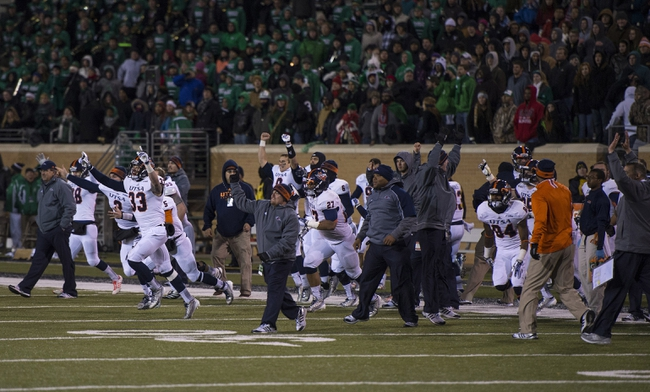 Nov 23, 2013; Denton, TX, USA; The UTSA Roadrunners celebrate the win over the North Texas Mean Green at Apogee Stadium. The Roadrunners defeated the Mean Green 21-13. Mandatory Credit: Jerome Miron-USA TODAY Sports