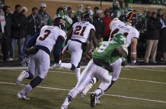 Nov 23, 2013; Denton, TX, USA; UTSA Roadrunners cornerback Bennett Okotcha (21) intercepts a pass on the last play of the game to seal the win against the North Texas Mean Green at Apogee Stadium. The Roadrunners defeated the Mean Green 21-13. Mandatory Credit: Jerome Miron-USA TODAY Sports