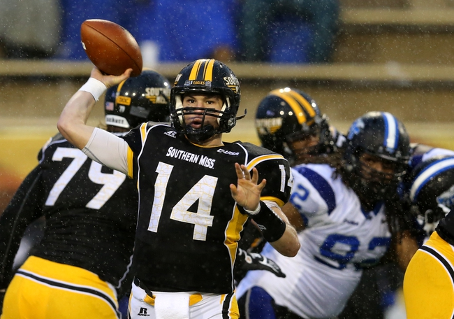 Nov 23, 2013; Hattiesburg, MS, USA; Southern Miss Golden Eagles quarterback Nick Mullens (14) makes a throw against the Middle Tennessee Blue Raiders during the second half at M.M. Roberts Stadium. Middle Tennessee won, 42-21. Mandatory Credit: Chuck Cook-USA TODAY Sports