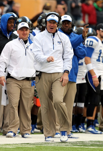 Nov 23, 2013; Hattiesburg, MS, USA; Middle Tennessee Blue Raiders head coach Rick Stockstill talks to an official in the first quarter of their game against the Southern Miss Golden Eagles at M.M. Roberts Stadium. Mandatory Credit: Chuck Cook-USA TODAY Sports