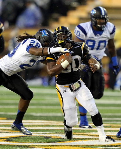Nov 23, 2013; Hattiesburg, MS, USA; Southern Miss Golden Eagles running back Jalen Richard (30) is tackled by Middle Tennessee Blue Raiders linebacker Christian Henry (28) in the second half of their game at M.M. Roberts Stadium. Middle Tennessee won, 42-21. Mandatory Credit: Chuck Cook-USA TODAY Sports
