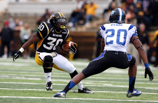 Nov 23, 2013; Hattiesburg, MS, USA; Southern Miss Golden Eagles running back Jalen Richard (30) tries to get around Middle Tennessee Blue Raiders safety Kevin Byard (20) in the first quarter of their game at M.M. Roberts Stadium. Mandatory Credit: Chuck Cook-USA TODAY Sports