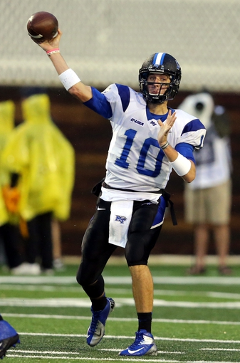 Nov 23, 2013; Hattiesburg, MS, USA; Middle Tennessee Blue Raiders quarterback Logan Kilgore (10) makes a throw against the Southern Miss Golden Eagles in the second half of their game at M.M. Roberts Stadium. Middle Tennessee won, 42-21. Mandatory Credit: Chuck Cook-USA TODAY Sports