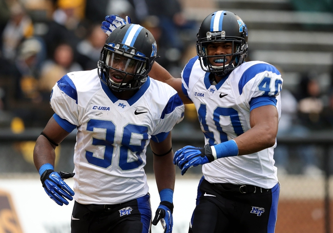Nov 23, 2013; Hattiesburg, MS, USA; Middle Tennessee Blue Raiders linebacker T.T. Barber (38) is congratulated by teammate Leighton Gasque (40) after his interception return touchdown against the Southern Miss Golden Eagles in the first quarter of their game at M.M. Roberts Stadium. Mandatory Credit: Chuck Cook-USA TODAY Sports
