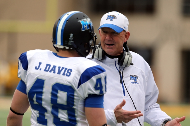 Nov 23, 2013; Hattiesburg, MS, USA; Middle Tennessee Blue Raiders head coach Rick Stockstill talks to punter Josh Davis (48) in the first quarter of their game at M.M. Roberts Stadium. Mandatory Credit: Chuck Cook-USA TODAY Sports