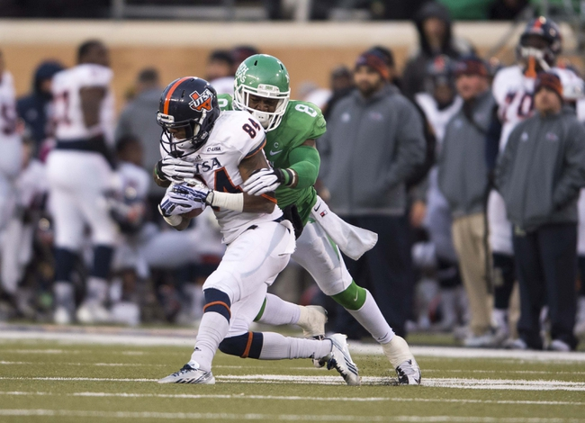 Nov 23, 2013; Denton, TX, USA; UTSA Roadrunners wide receiver Brandon Freeman (84) is tackled by North Texas Mean Green defensive back Marcus Trice (8) during the second half at Apogee Stadium. The Roadrunners defeated the Mean Green 21-13. Mandatory Credit: Jerome Miron-USA TODAY Sports