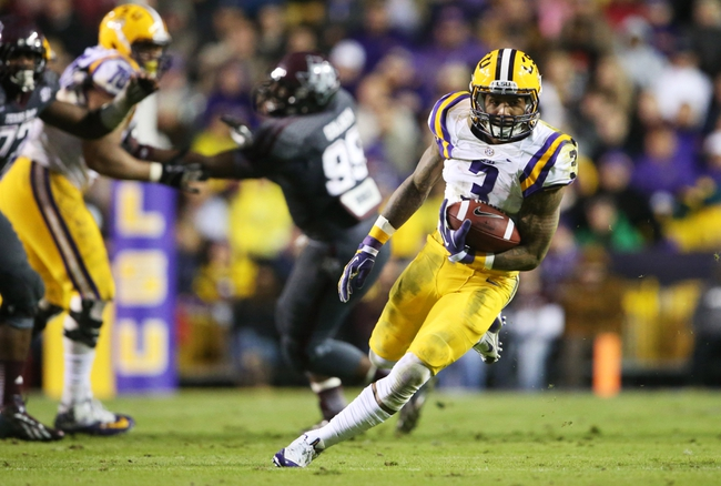 Nov 23, 2013; Baton Rouge, LA, USA; LSU Tigers wide receiver Odell Beckham (3) carries the ball against the Texas A&M Aggies in the second half at Tiger Stadium. LSU defeated Texas A&M 34-10. Mandatory Credit: Crystal LoGiudice-USA TODAY Sports