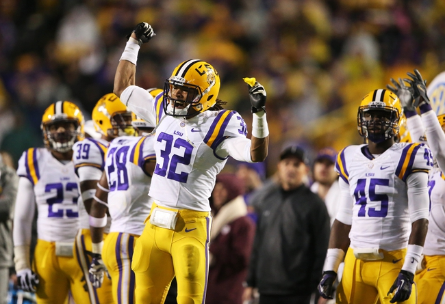 Nov 23, 2013; Baton Rouge, LA, USA; LSU Tigers cornerback Jalen Collins (32) celebrates after a call on the field was overturned giving the Tigers the ball in the second half against the Texas A&M Aggies at Tiger Stadium. LSU defeated Texas A&M 34-10. Mandatory Credit: Crystal LoGiudice-USA TODAY Sports