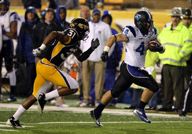Nov 23, 2013; Hattiesburg, MS, USA; Middle Tennessee Blue Raiders fullback Corey Carmichael (44) runs away from Southern Miss Golden Eagles defensive back Alexander Walters (31) for a 32-yard touchdown run in the second half of their game at M.M. Roberts Stadium. Middle Tennessee won, 42-21. Mandatory Credit: Chuck Cook-USA TODAY Sports