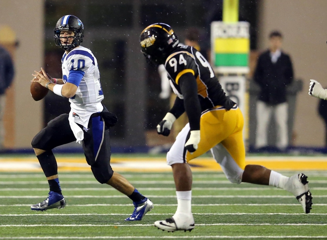 Nov 23, 2013; Hattiesburg, MS, USA; Middle Tennessee Blue Raiders quarterback Logan Kilgore (10) looks to throw while under pressure from Southern Miss Golden Eagles defensive lineman Dylan Bradley (94) in the second half of their game at M.M. Roberts Stadium. Middle Tennessee won, 42-21. Mandatory Credit: Chuck Cook-USA TODAY Sports