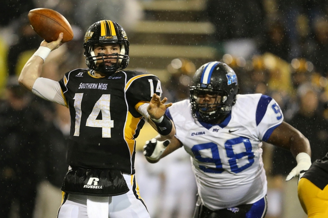 Nov 23, 2013; Hattiesburg, MS, USA; Southern Miss Golden Eagles quarterback Nick Mullens (14) throws under pressure from Middle Tennessee Blue Raiders defensive tackle Derious Bennett (98) in the second half of their game at M.M. Roberts Stadium. Middle Tennessee won, 42-21. Mandatory Credit: Chuck Cook-USA TODAY Sports