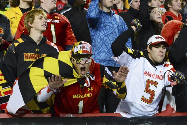 Nov 23, 2013; College Park, MD, USA;  Maryland student Alex Jonesi and Dylan French celebrates after Maryland Terrapins quarterback C.J. Brown (16) touchdown  during the fourth quarter of the game against the Boston College Eagles at Byrd Stadium. Boston College Eagles defeated Maryland Terrapins 29-26. Mandatory Credit: Tommy Gilligan-USA TODAY Sports