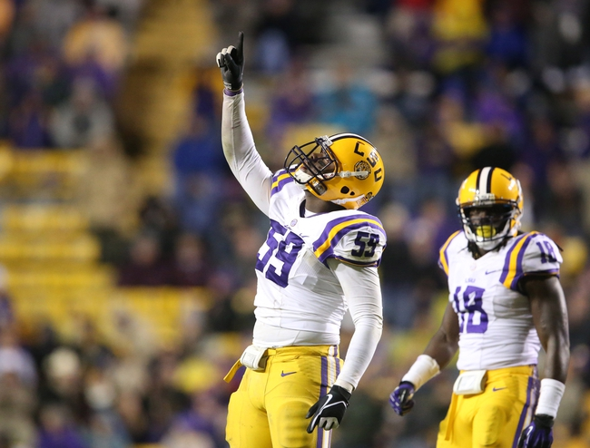 Nov 23, 2013; Baton Rouge, LA, USA; LSU Tigers defensive end Jermauria Rasco (59) celebrates after sacking Texas A&M Aggies quarterback Johnny Manziel (not pictured) in the second half at Tiger Stadium. LSU defeated Texas A&M 34-10. Mandatory Credit: Crystal LoGiudice-USA TODAY Sports