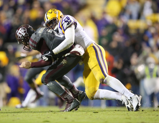 Nov 23, 2013; Baton Rouge, LA, USA; LSU Tigers defensive end Jermauria Rasco (59) sacks Texas A&M Aggies quarterback Johnny Manziel (2) in the second half at Tiger Stadium. LSU defeated Texas A&M 34-10. Mandatory Credit: Crystal LoGiudice-USA TODAY Sports