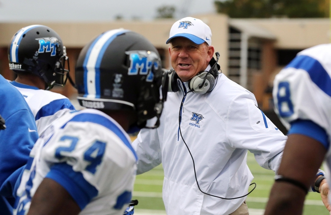 Nov 23, 2013; Hattiesburg, MS, USA; Middle Tennessee Blue Raiders head coach Rick Stockstill speaks to his players on the sidelines in the first quarter of their game against the Southern Miss Golden Eagles at M.M. Roberts Stadium. Mandatory Credit: Chuck Cook-USA TODAY Sports