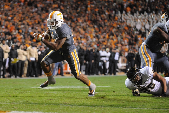 Nov 23, 2013; Knoxville, TN, USA; Tennessee Volunteers running back Rajion Neal (20) scores a touchdown against the Vanderbilt Commodores during the second quarter at Neyland Stadium. Mandatory Credit: Randy Sartin-USA TODAY Sports