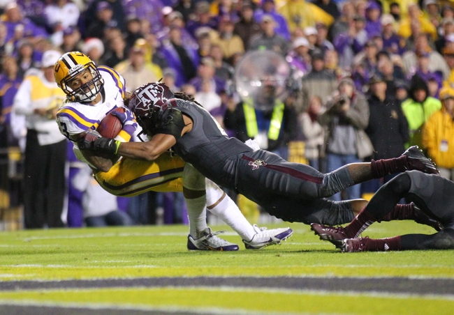 Nov 23, 2013; Baton Rouge, LA, USA;LSU Tigers wide receiver Odell Beckham (3) is tackled by Texas A&M Aggies defensive back Floyd Raven Sr. (5) in the second half at Tiger Stadium. LSU defeated Texas A&M 34-10. Mandatory Credit: Crystal LoGiudice-USA TODAY Sports