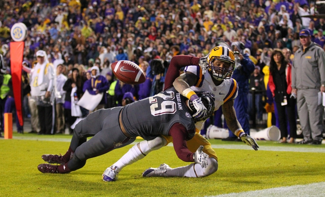 Nov 23, 2013; Baton Rouge, LA, USA; Texas A&M Aggies defensive back Deshazor Everett (29) is tackled after breaking up a pass in the end zone intended for LSU Tigers wide receiver Odell Beckham (3) in the second half at Tiger Stadium. LSU defeated Texas A&M 34-10. Mandatory Credit: Crystal LoGiudice-USA TODAY Sports