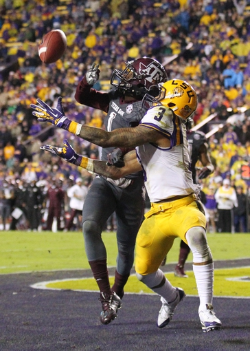Nov 23, 2013; Baton Rouge, LA, USA; Texas A&M Aggies defensive back De'Vante Harris (1) breaks up a pass in the end zone intended for LSU Tigers wide receiver Odell Beckham (3) in the second half at Tiger Stadium. LSU defeated Texas A&M 34-10. Mandatory Credit: Crystal LoGiudice-USA TODAY Sports