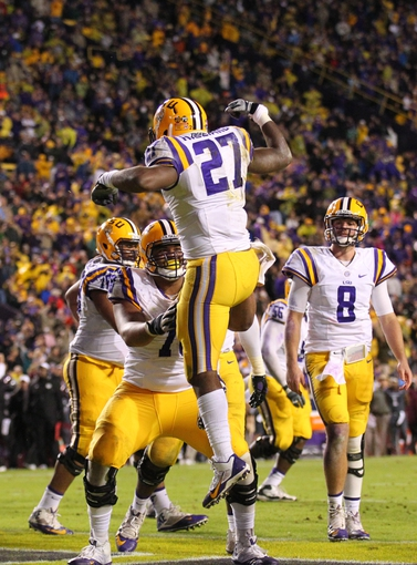 Nov 23, 2013; Baton Rouge, LA, USA; LSU Tigers running back Kenny Hilliard (27) is congratulated by offensive tackle La'el Collins (70) after a touchdown against the Texas A&M Aggies in the second half at Tiger Stadium. LSU defeated Texas A&M 34-10. Mandatory Credit: Crystal LoGiudice-USA TODAY Sports