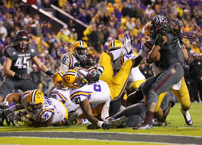 Nov 23, 2013; Baton Rouge, LA, USA; LSU Tigers running back Kenny Hilliard (27) falls into the end zone for a touchdown against the Texas A&M Aggies in the second half at Tiger Stadium. LSU defeated Texas A&M 34-10. Mandatory Credit: Crystal LoGiudice-USA TODAY Sports