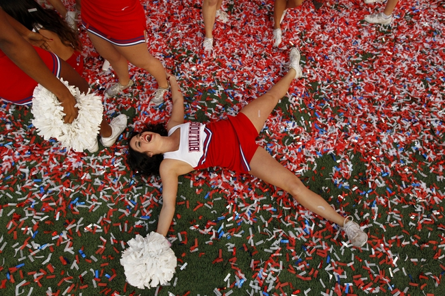 Nov 23, 2013; Fresno, CA, USA; Fresno State Bulldogs cheerleader Courtney Bianchi celebrates in confetti after the Bulldogs defeated the New Mexico Lobos to win the West division of the Mountain West Conference at Bulldog Stadium. The Bulldogs defeated the Lobos 69-28. Mandatory Credit: Cary Edmondson-USA TODAY Sports