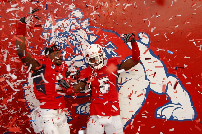 Nov 23, 2013; Fresno, CA, USA; Fresno State Bulldogs defensive back Jamal Ellis (2) and defensive back Dalen Jones (5) celebrate after the Bulldogs defeated the New Mexico Lobos to win the West Division of the Mountain West Conference at Bulldog Stadium. The Bulldogs defeated the Lobos 69-28. Mandatory Credit: Cary Edmondson-USA TODAY Sports