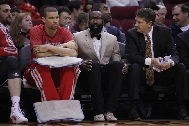 Nov 23, 2013; Houston, TX, USA; Houston Rockets shooting guard James Harden wears a suit on the bench during the first quarter at Toyota Center. Mandatory Credit: Andrew Richardson-USA TODAY Sports
