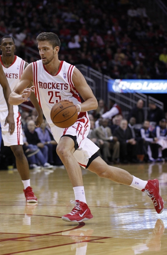 Nov 23, 2013; Houston, TX, USA; Houston Rockets small forward Chandler Parsons (25) drives to the basket during the first quarter at Toyota Center. Mandatory Credit: Andrew Richardson-USA TODAY Sports