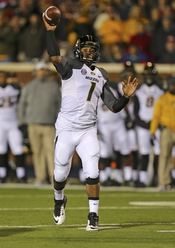 Nov 23, 2013; Oxford, MS, USA; Missouri Tigers quarterback Maty Mauk (7) passes the ball during the game against the Mississippi Rebels at Vaught-Hemingway Stadium. Mandatory Credit: Spruce Derden-USA TODAY Sports
