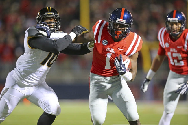 Nov 23, 2013; Oxford, MS, USA; Mississippi Rebels wide receiver Laquon Treadwell (1) catches the ball and tries to free himself from Missouri Tigers linebacker Kentrell Brothers (10) during the game at Vaught-Hemingway Stadium. Mandatory Credit: Spruce Derden-USA TODAY Sports