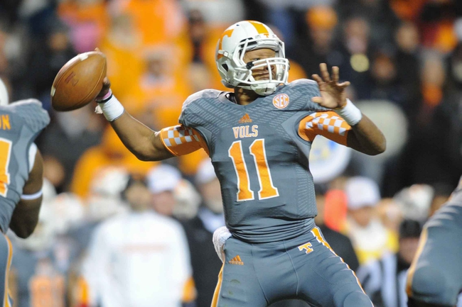 Nov 23, 2013; Knoxville, TN, USA; Tennessee Volunteers quarterback Joshua Dobbs (11) passes the ball against the Vanderbilt Commodores during the second quarter at Neyland Stadium. Mandatory Credit: Randy Sartin-USA TODAY Sports