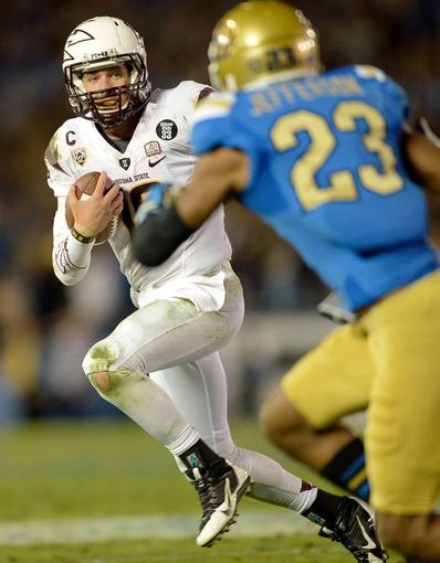Nov 23, 2013; Pasadena, CA, USA; Arizona State Sun Devils quarterback Taylor Kelly (10) tries to run past UCLA Bruins cornerback Anthony Jefferson (23) during first half action at Rose Bowl. Mandatory Credit: Robert Hanashiro-USA TODAY Sports