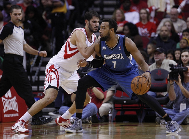 Nov 23, 2013; Houston, TX, USA; Minnesota Timberwolves power forward Derrick Williams (7) is guarded by Houston Rockets small forward Omri Casspi (18) during the second quarter at Toyota Center. Mandatory Credit: Andrew Richardson-USA TODAY Sports