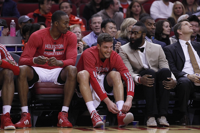 Nov 23, 2013; Houston, TX, USA; Houston Rockets power forward Dwight Howard (left), small forward Chandler Parsons (center), and shooting guard James Harden (right) on the bench during the second quarter at Toyota Center. Mandatory Credit: Andrew Richardson-USA TODAY Sports