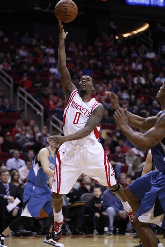 Nov 23, 2013; Houston, TX, USA; Houston Rockets point guard Aaron Brooks (0) shoots the ball during the second quarter at Toyota Center. Mandatory Credit: Andrew Richardson-USA TODAY Sports