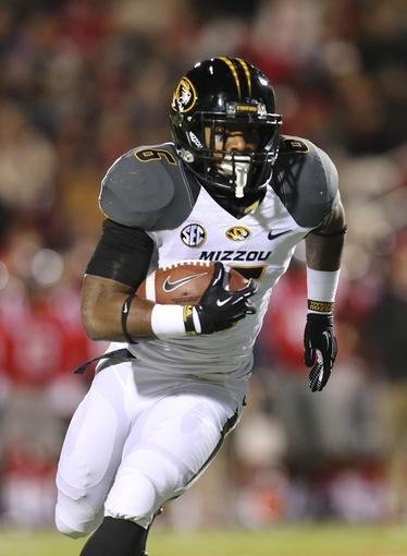 Nov 23, 2013; Oxford, MS, USA; Missouri Tigers running back Marcus Murphy (6) advances the ball during the game against the Mississippi Rebels at Vaught-Hemingway Stadium. Mandatory Credit: Spruce Derden-USA TODAY Sports