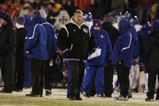 Nov 23, 2013; Ames, IA, USA; Kansas Jayhawks head coach Charlie Weis walks the sideline during the game against the Iowa State Cyclones in the second quarter at Jack Trice Stadium. Mandatory Credit: Bruce Thorson-USA TODAY Sports