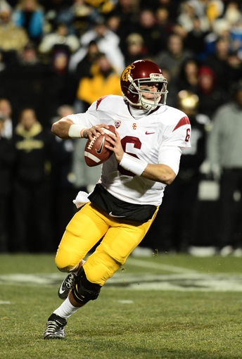 Nov 23, 2013; Boulder, CO, USA; Southern California Trojans quarterback Cody Kessler (6) prepares to pass  in the first quarter against the Colorado Buffaloes at Folsom Field. Mandatory Credit: Ron Chenoy-USA TODAY Sports