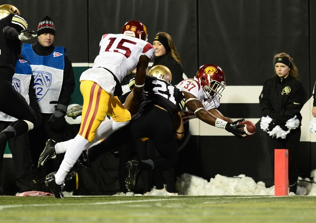 Nov 23, 2013; Boulder, CO, USA; Colorado Buffaloes defensive back Jered Bell (21) is unable to stop Southern California Trojans running back Javorius Allen (37) from scoring a touchdown in the first quarter at Folsom Field. Mandatory Credit: Ron Chenoy-USA TODAY Sports